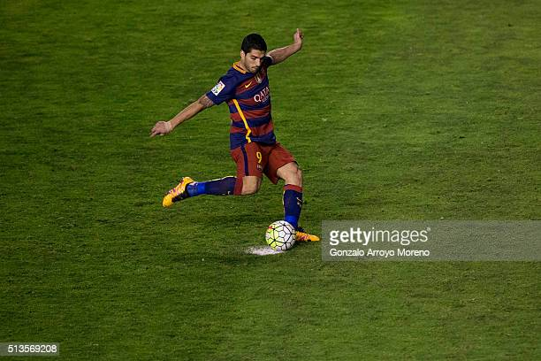 Luis Suarez of FC Barcelona strikes a penalty shot during the La Liga match between Rayo Vallecano de Madrid and FC Barcelona at Estadio de Vallecas...