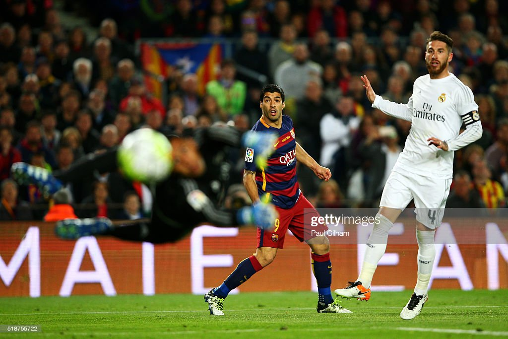Luis Suarez of FC Barcelona watches his shot fly past Keylor Navas of Real Madrid CF and wide of the post as Sergio Ramos of Real Madrid CF looks on during the La Liga match between FC Barcelona and Real Madrid CF at Camp Nou on April 2, 2016 in Barcelona, Spain.