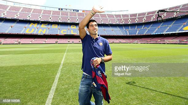 Luis Suarez of FC Barcelona waves during his presentation as new FC Barcelona player at Camp Nou on August 19 2014 in Barcelona Spain