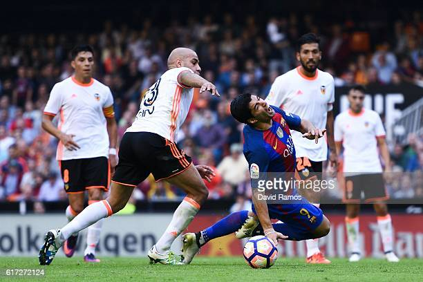 Luis Suarez of FC Barcelona wins a penalty as he is brought down by Aymen Abdennour of Valencia CF during the La Liga match between Valencia CF and...