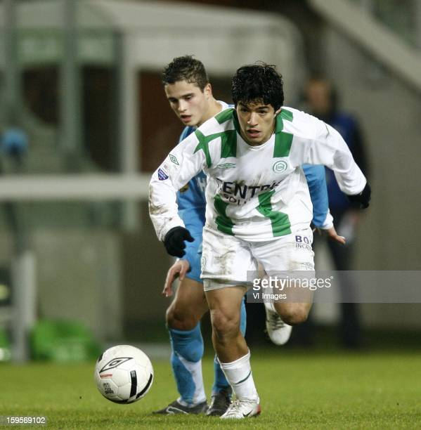 Luis Suarez of FC Groningen Ibrahim Afellay of PSV during the Dutch Eredivisie match between FC Groningen and PSV Eindhoven on December 10 2006 at...