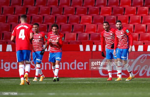 Luis Suarez of Granada CF celebrates with team mates after scoring their sides first goal during the La Liga Santander match between Granada CF and...