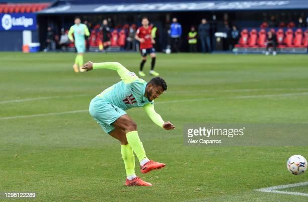 Luis Suarez of Granada CF scores their side's first goal during the La Liga Santander match between C.A. Osasuna and Granada CF at Estadio El Sadar...