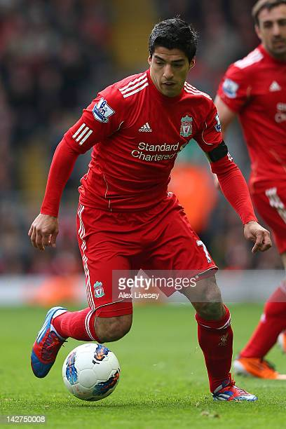 Luis Suarez of Liverpoo lruns with the ball during the Barclays Premier League match between Liverpool and Aston Villa at Anfield on April 7 2012 in...