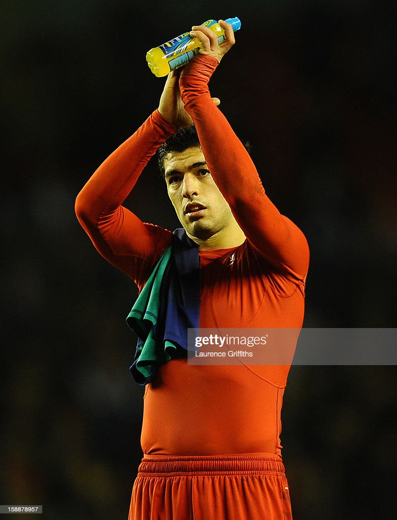 Luis Suarez of Liverpool acknowledges the fans at the end of the Barclays Premier League match between Liverpool and Sunderland at Anfield on January 2, 2013 in Liverpool, England.