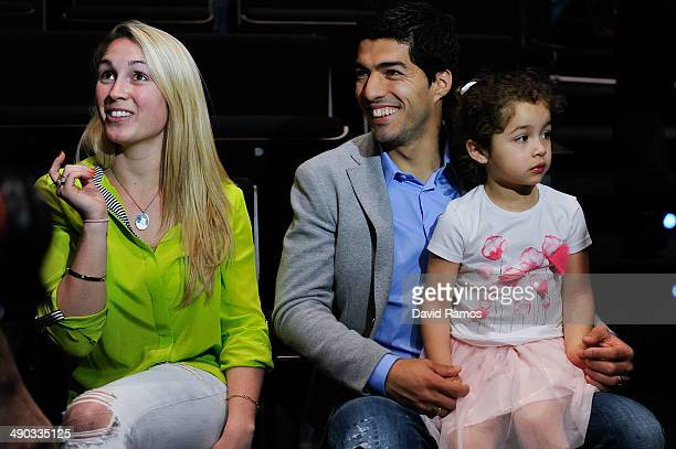 Luis Suarez of Liverpool and his wife Sofia Balbi sit with their daughter Delfina during the presentation as new Ambassador for 888poker on May 14...