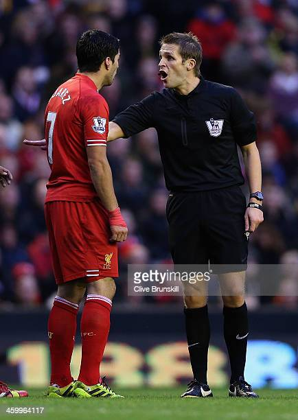 Luis Suarez of Liverpool argues with referee Mr C Pawson during the Barclays Premier League match between Liverpool and Hull City at Anfield on...