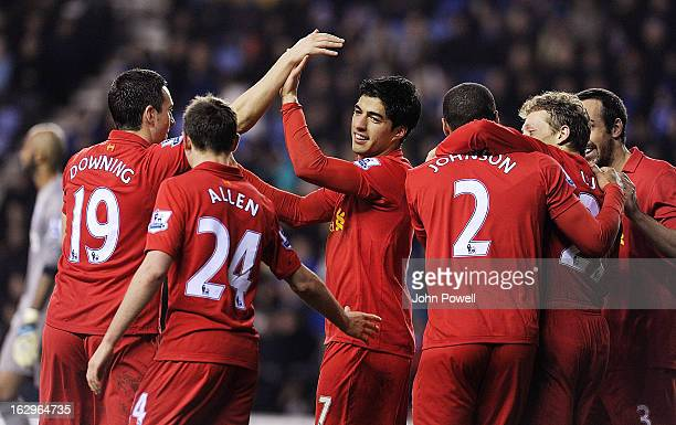 Luis Suarez of Liverpool celebrates after scoring a hattrick during the Barclays Premier League match between Wigan Athletic and Liverpool at DW...