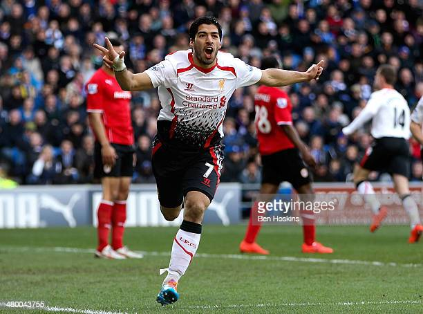 Luis Suarez of Liverpool celebrates after scoring his team's fourth goal of the game during the Barclays Premier League match between Cardiff City...