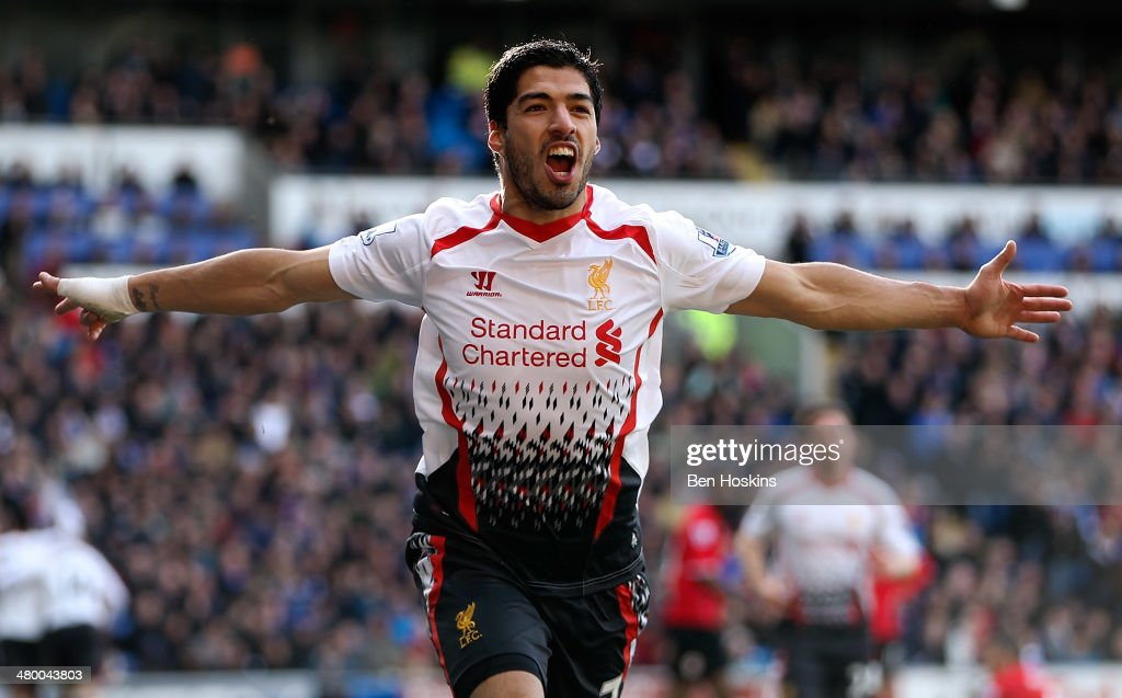 Luis Suarez of Liverpool celebrates after scoring his team's fourth goal of the game during the Barclays Premier League match between Cardiff City and Liverpool at Cardiff City Stadium on March 22, 2014 in Cardiff, Wales.