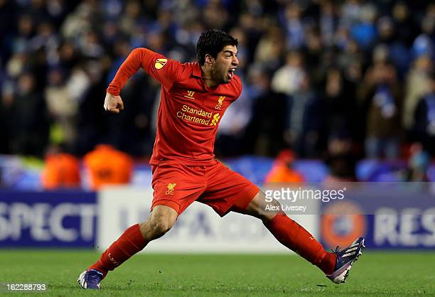 Luis Suarez of Liverpool celebrates after scoring his team's third goal from a free kick during the UEFA Europa League round of 32 second leg match...