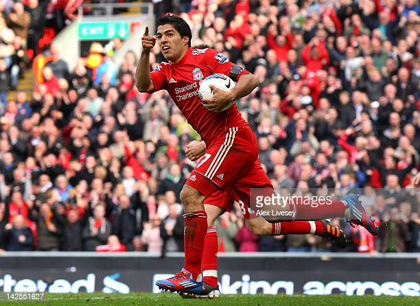 Luis Suarez of Liverpool celebrates after scoring the equalizing goal during the Barclays Premier League match between Liverpool and Aston Villa at...