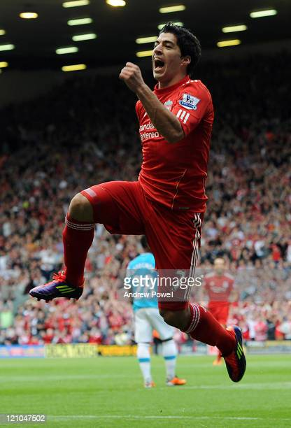 Luis Suarez of Liverpool celebrates after scoring the opening goal during the Barclays Premier League match between Liverpool and Sunderland at...