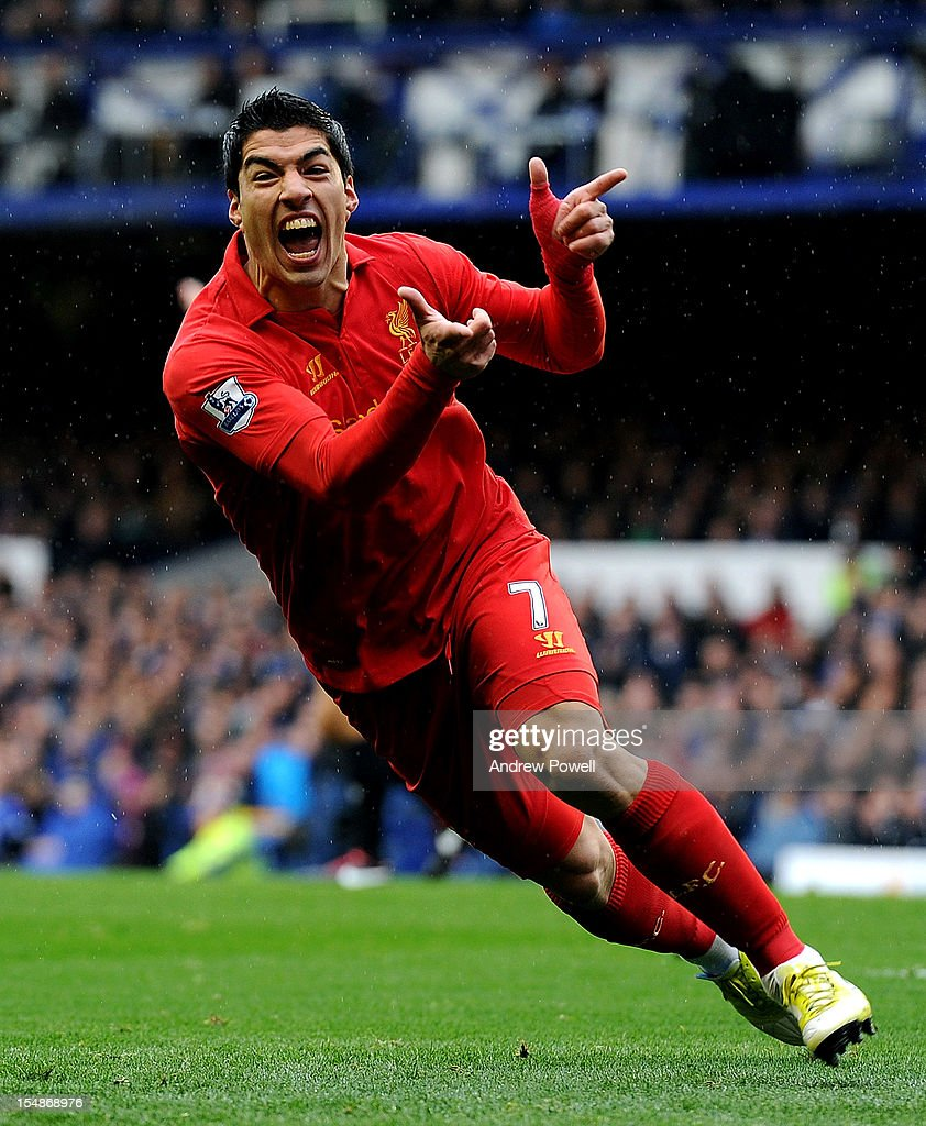 Luis Suarez of Liverpool celebrates after scoring the opening goal during the Barclays Premier League match between Everton and Liverpool at Goodison Park on October 28, 2012 in Liverpool, England.