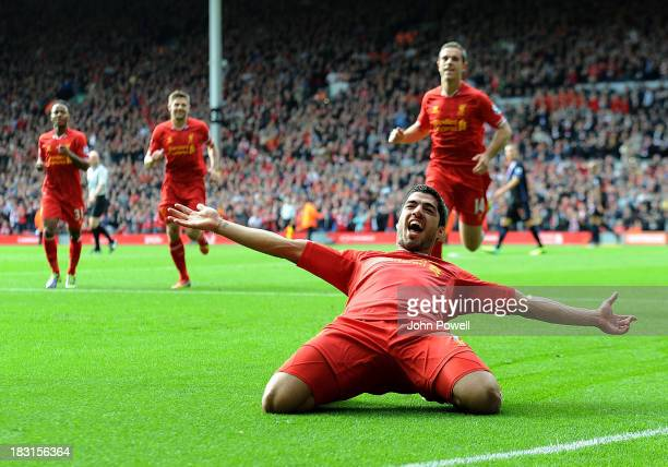 Luis Suarez of Liverpool celebrates after scoring the opening goal during the Barclays Premier League match between Liverpool and Crystal Palace at...