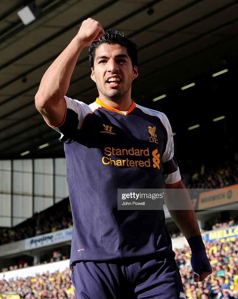 Luis Suarez of Liverpool celebrates after scoring the second during the Barclays Premier League match between Norwich City and Liverpool at Carrow Road on September 29, 2012 in Norwich, England.