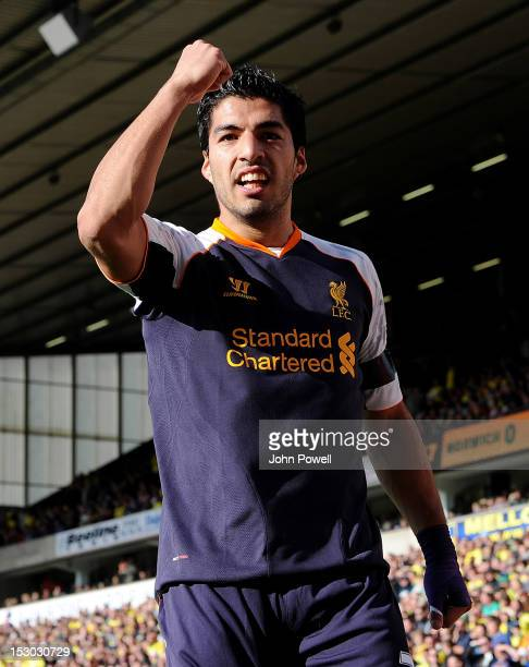 Luis Suarez of Liverpool celebrates after scoring the second during the Barclays Premier League match between Norwich City and Liverpool at Carrow...