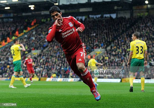 Luis Suarez of Liverpool celebrates after scoring the second goal during the Barclays Premier League match between Norwich City and Liverpool at...