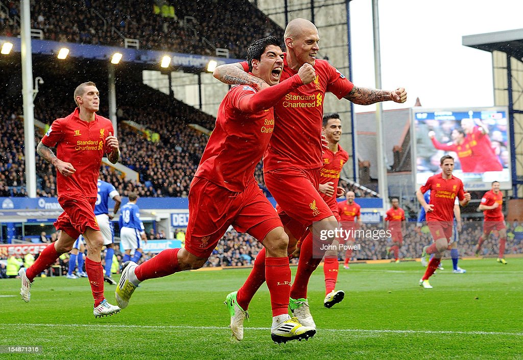 Luis Suarez of Liverpool celebrates after scoring the second goal during the Barclays Premier League match between Everton and Liverpool at Goodison Park on October 28, 2012 in Liverpool, England.