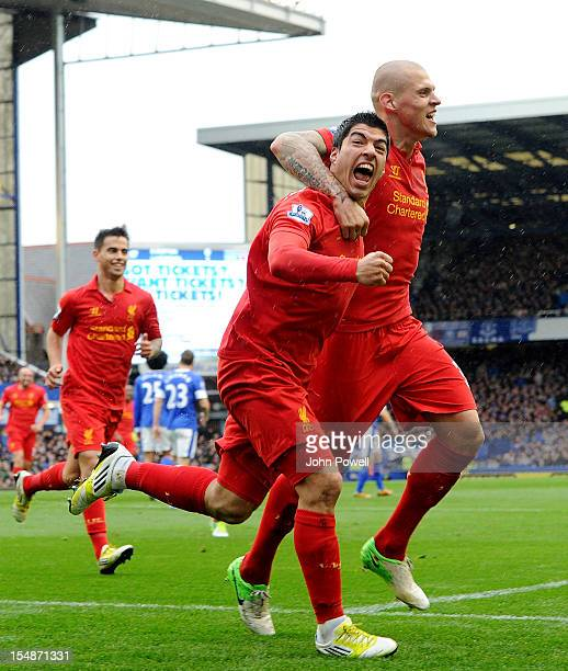Luis Suarez of Liverpool celebrates after scoring the second goal during the Barclays Premier League match between Everton and Liverpool at Goodison...