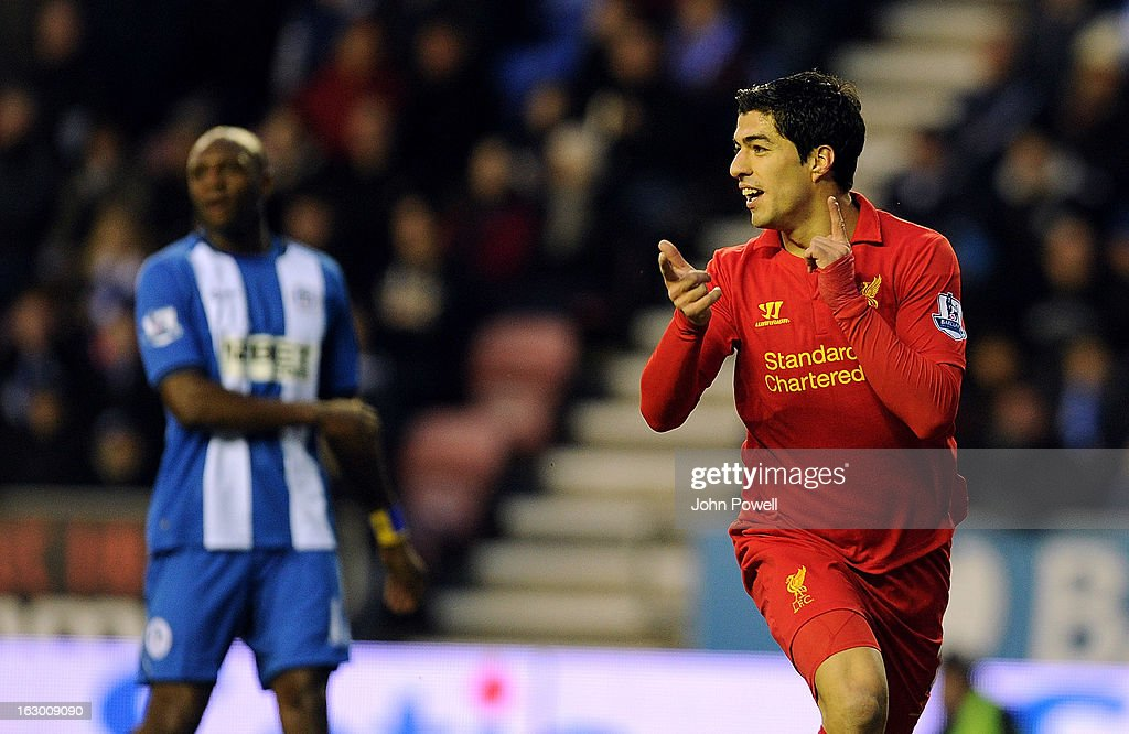Luis Suarez of Liverpool celebrates after scoring the second goal during the Barclays Premier League match between Wigan Athletic and Liverpool at DW Stadium on March 2, 2013 in Wigan, England.