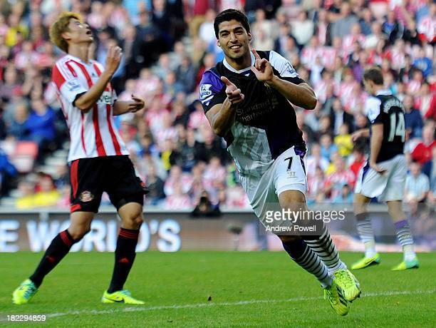 Luis Suarez of Liverpool celebrates after scoring the third goal during the Barclays Premier League match between Sunderland and Liverpool at Stadium...