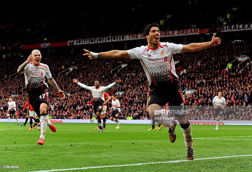 Luis Suarez of Liverpool celebrates after scoring the third goal during the Barclays Premier Leauge match between Manchester United and Liverpool at Old Trafford on March 16, 2014 in Manchester, England.