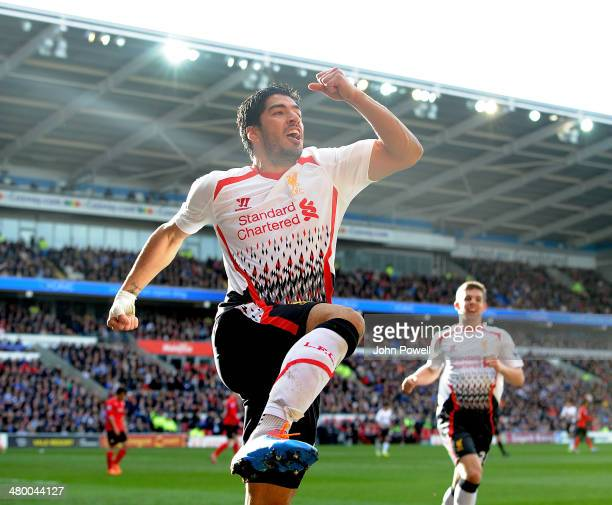Luis Suarez of Liverpool celebrates after scoring their fourth goal during the Barclays Premier League match between Cardiff City and Liverpool at...