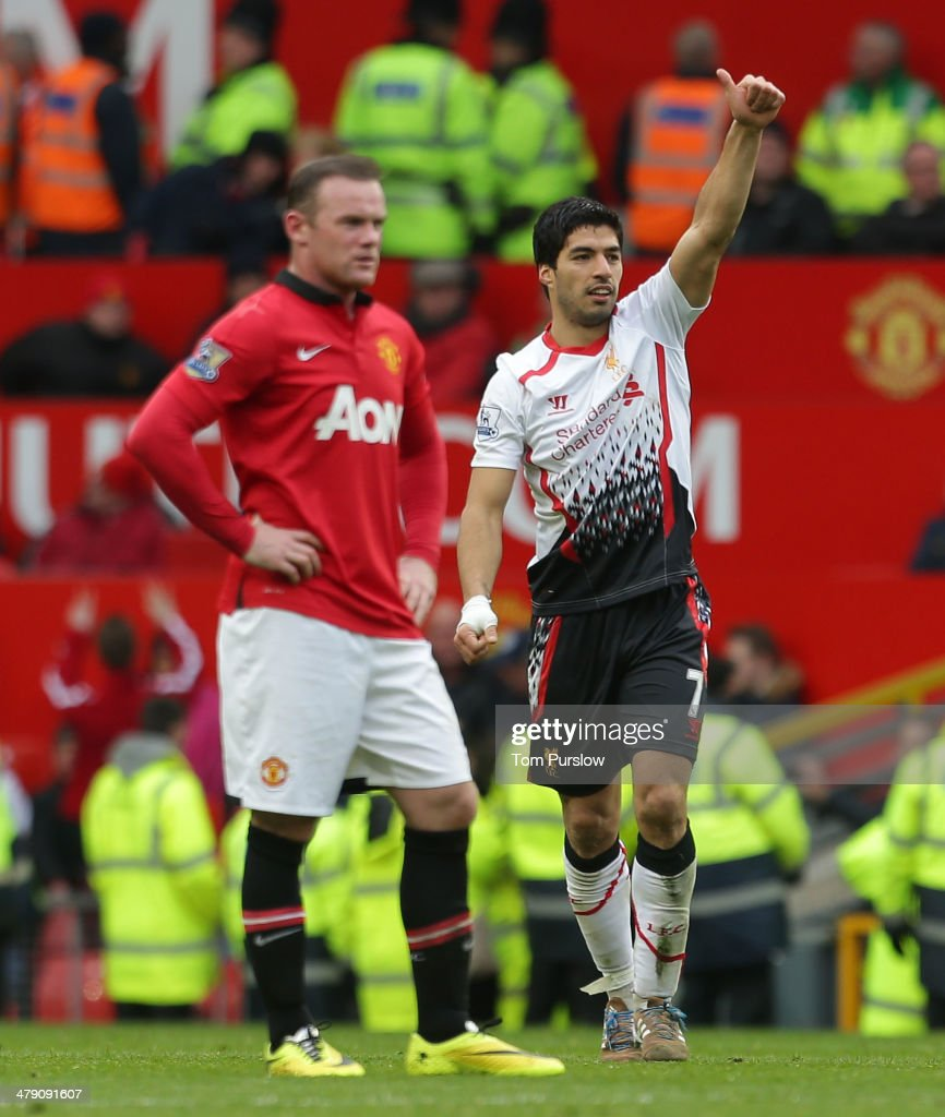 Luis Suarez of Liverpool celebrates after scoring their third goal during the Barclays Premier League match between Manchester United and Liverpool at Old Trafford on March 16, 2014 in Manchester, England.