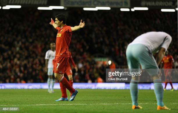Luis Suarez of Liverpool celebrates afterJoey O'Brien of West Ham United scored an own goal during the Barclays Premier League match between...