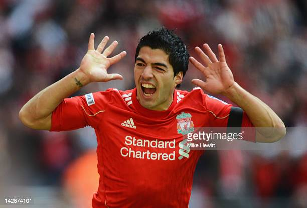 Luis Suarez of Liverpool celebrates as he scores their first goal during the FA Cup with Budweiser Semi Final match between Liverpool and Everton at...