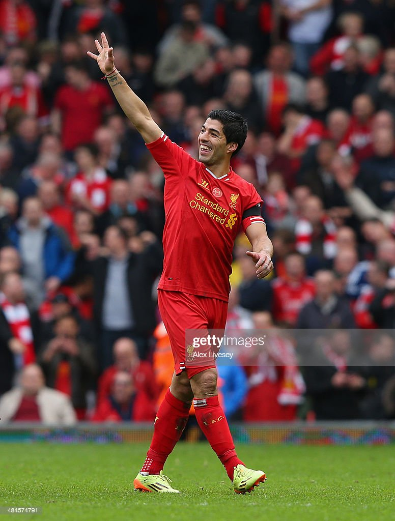 Luis Suarez of Liverpool celebrates at the end of the Barclays Premier League match between Liverpool and Manchester City at Anfield on April 13, 2014 in Liverpool, England.