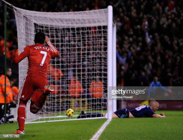Luis Suarez of Liverpool celebrates his 20 goal while Andy Wilkinson of Stoke lies dejected on the pitch during the Barclays Premier League match...