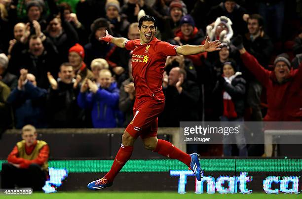Luis Suarez of Liverpool celebrates his first goal from a long range effort during the Barclays Premier League match between Liverpool and Norwich...