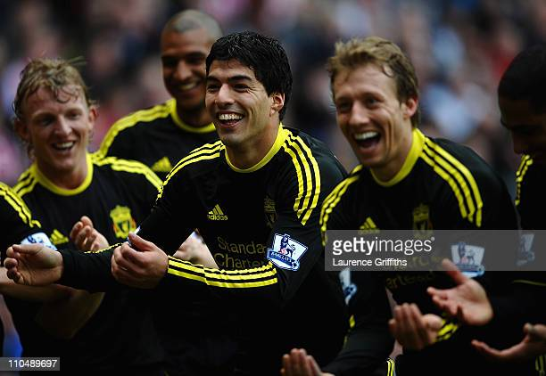 Luis Suarez of Liverpool celebrates his goal alongside Lucas Leiva Dirk Kuyt and Raul Meireles during the Barclays Premier League match between...