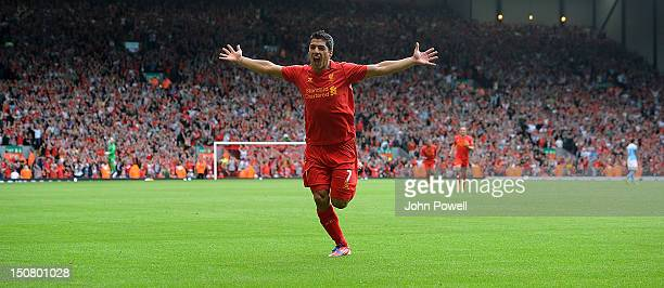Luis Suarez of Liverpool celebrates his goal during the Barclays Premier League match between Liverpool and Manchester City at Anfield on August 26...