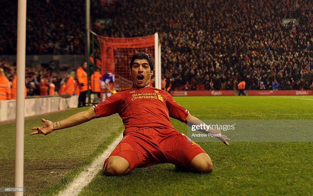 Luis Suarez of Liverpool celebrates his goal during the Barclays Premier League match between Liverpool and Everton at Anfield on January 28, 2014 in Liverpool, England.