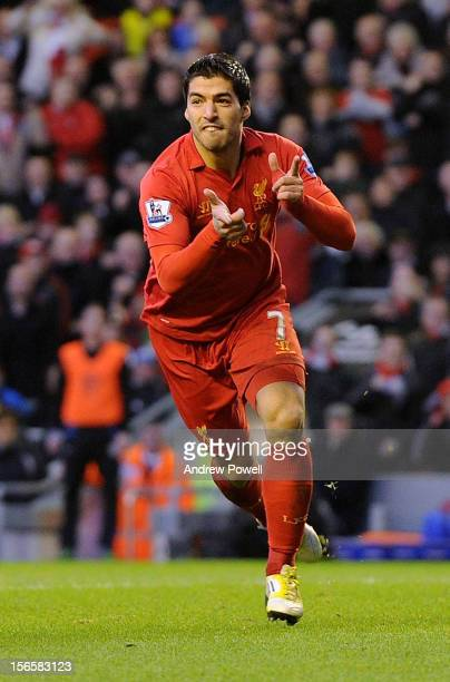 Luis Suarez of Liverpool celebrates his goal making it 10 during the Barclays Premier League match between Liverpool and Wigan Athletic at Anfield on...