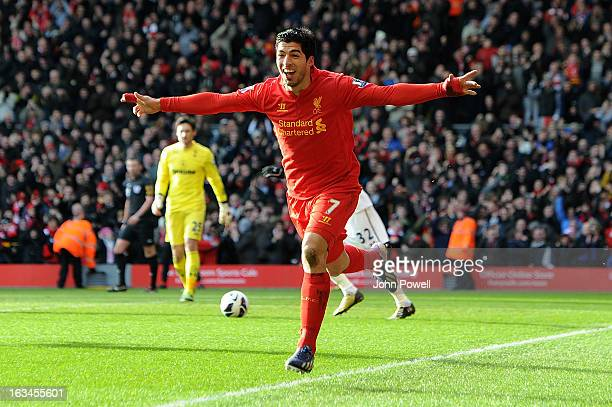 Luis Suarez of Liverpool celebrates his goal to make it 10 during the Barclays Premier League match between Liverpool and Tottenham Hotspur at...