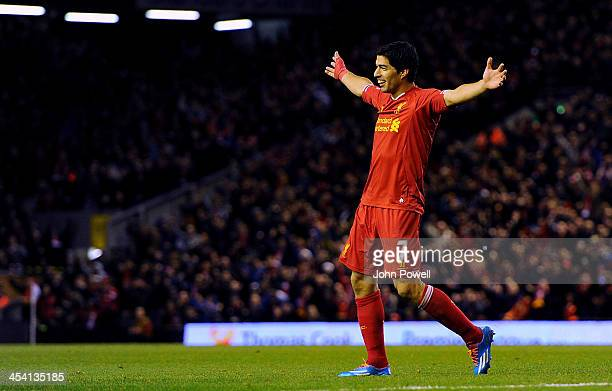 Luis Suarez of Liverpool celebrates his second goal during the Barclays Premier League match between Liverpool and West Ham United at Anfield on...