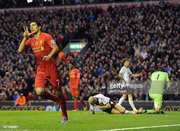 Luis Suarez of Liverpool celebrates his third goal during the Barclays Premier League Match between Liverpool and Fulham at Anfield on November 9...