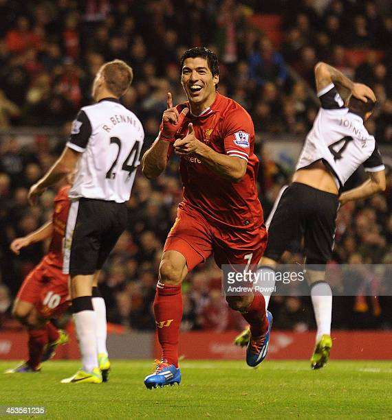 Luis Suarez of Liverpool celebrates his third goal during the Barclays Premier League match between Liverpool and Norwich City at Anfield on December...