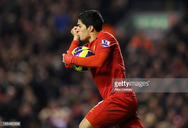 Luis Suarez of Liverpool celebrates scoring his team's first goal to make the score 11 during the Barclays Premier League match between Liverpool and...
