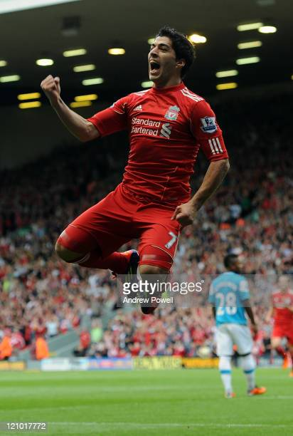 Luis Suarez of Liverpool celebrates scoring his team's opening goal during the Barclays Premier League match between Liverpool and Sunderland at...