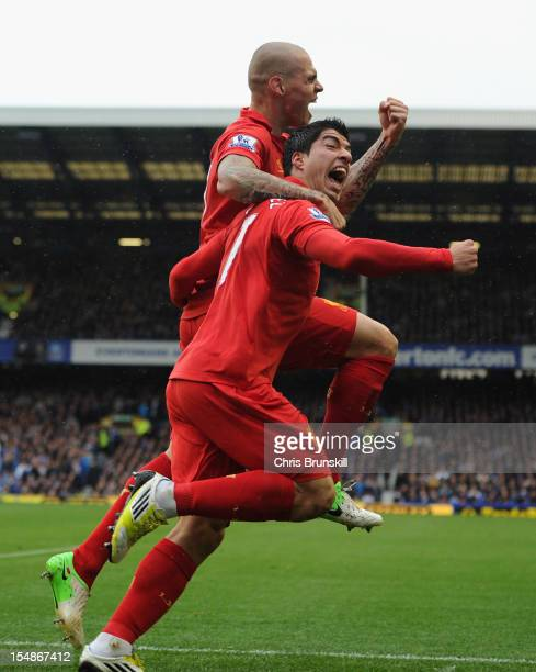 Luis Suarez of Liverpool celebrates scoring his team's second goal with team mate Martin Skrtel during the Barclays Premier League match between...