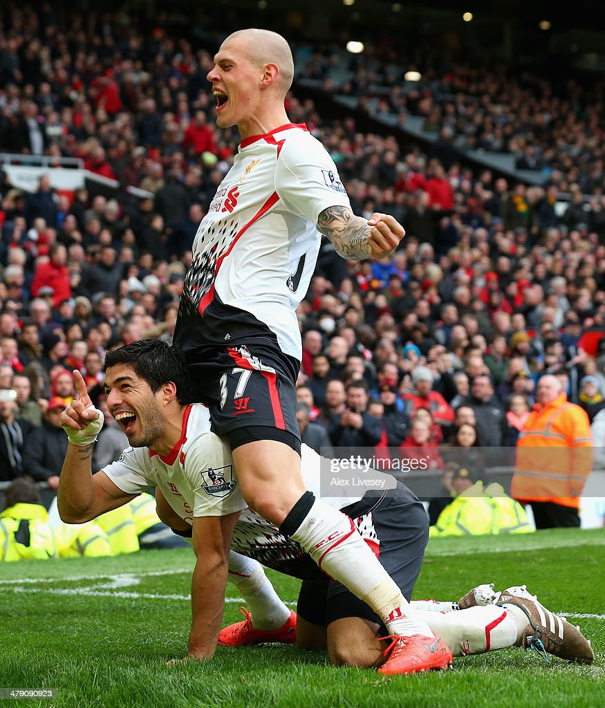 Luis Suarez of Liverpool celebrates scoring his team's third goal with Martin Skrtel (R) during the Barclays Premier League match between Manchester United and Liverpool at Old Trafford on March 16, 2014 in Manchester, England.