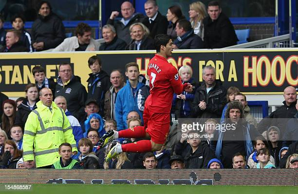 Luis Suarez of Liverpool celebrates scoring the opening goal during the Barclays Premier League match between Everton and Liverpool at Goodison Park...