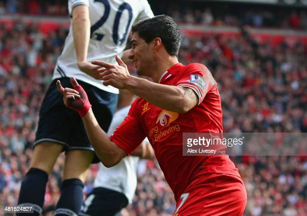 Luis Suarez of Liverpool celebrates scoring the second goal during the Barclays Premier League match between Liverpool and Tottenham Hotspur at...