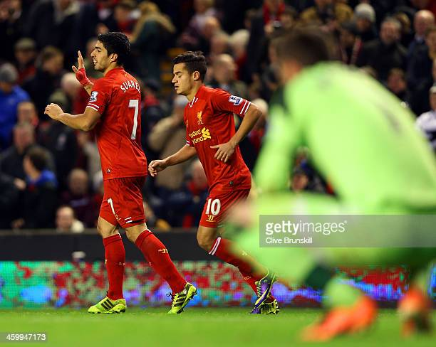 Luis Suarez of Liverpool celebrates scoring their second goal with Philippe Coutinho of Liverpool during the Barclays Premier League match between...