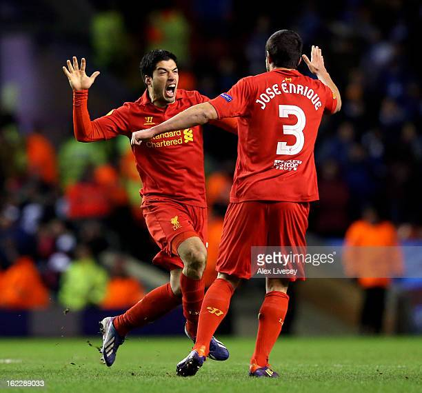 Luis Suarez of Liverpool celebrates with teammate Jose Enrique after scoring his team's third goal from a free kick during the UEFA Europa League...